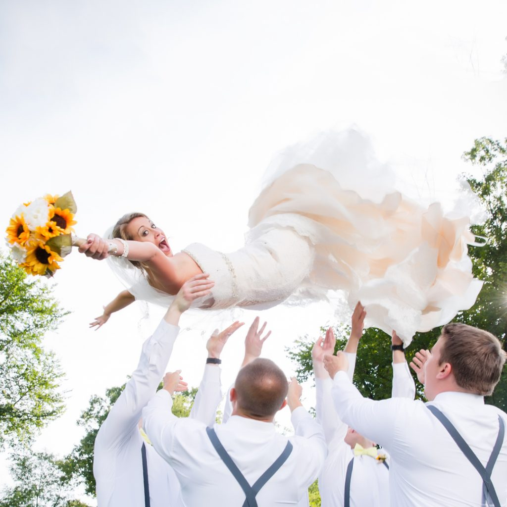 Congratulations Mr. & Mrs. Bible! We never expected you to go airborne but we're sure glad you did! This is easily one of the best ever wedding moments!